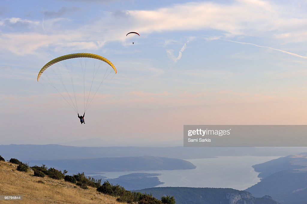Paragliders flying at sunset, Sainte-Croix lake : Stock Photo