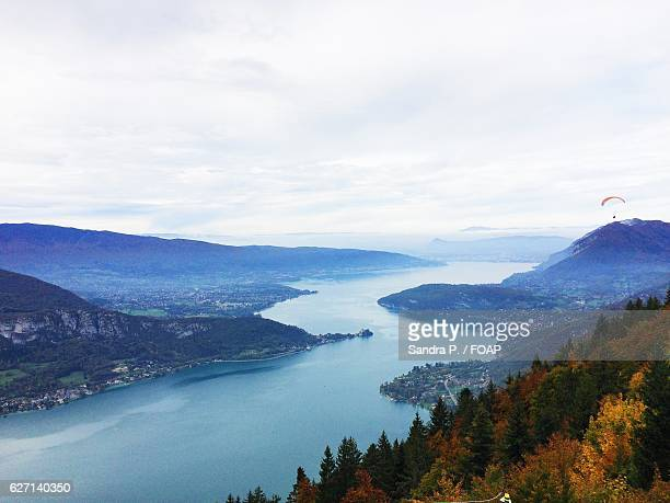 paragliders on top of the annecy lake - lake annecy stock photos and pictures