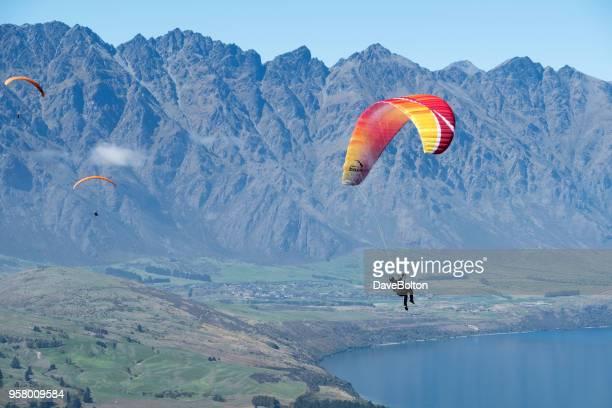 Paragliders over Queenstown New Zealand