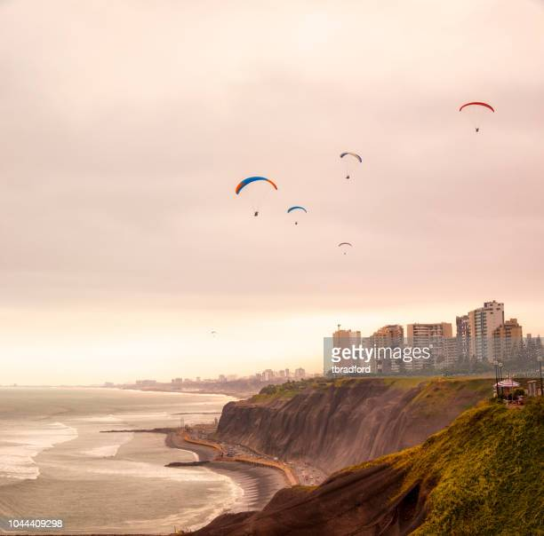 paragliders over the coast in lima, peru - peru stock pictures, royalty-free photos & images