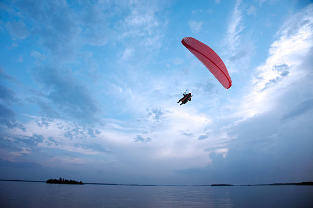 Paragliding Above The Lake. Wall Art