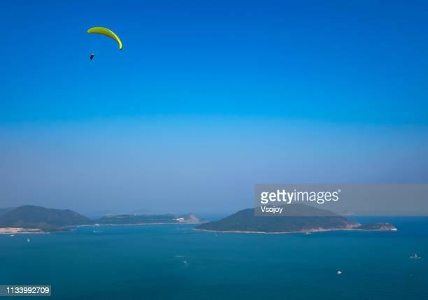paragliding at long ji (dragon's back), shek o in hong kong - vsojoy stock pictures, royalty-free photos & images