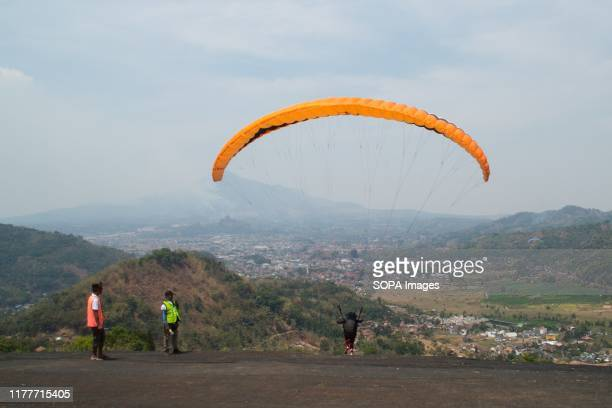 A paragliding athlete participates in the Championship at Kampung Toga Sumedang The 2019 West Java Paragliding World Championship event was attended...