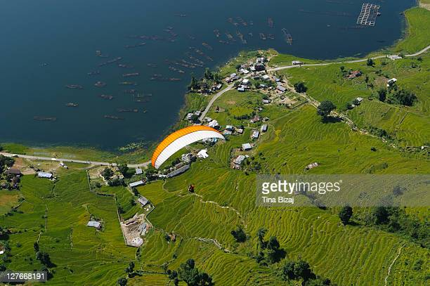 paragliding from sarangkot - nepal stock pictures, royalty-free photos & images