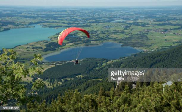 Paragliding  near Fussen, Lake Forggensee and lake Bannwaldsee in Fuessen, Germany