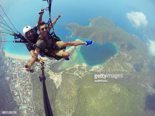 paragliding on oludeniz fethiye - mugla province stock pictures, royalty-free photos & images