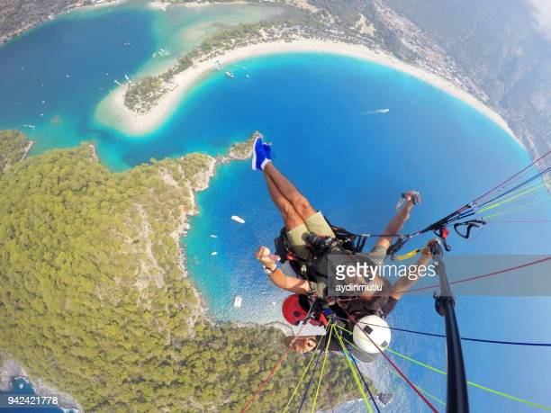 paragliding on oludeniz fethiye - aegean turkey stock pictures, royalty-free photos & images