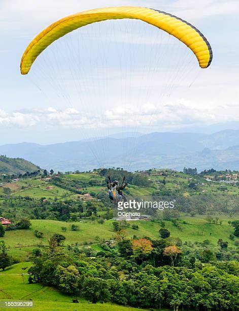 Paragliding over a rolling landscape