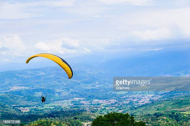 paragliding over a rolling landscape - ogphoto stock photos and pictures