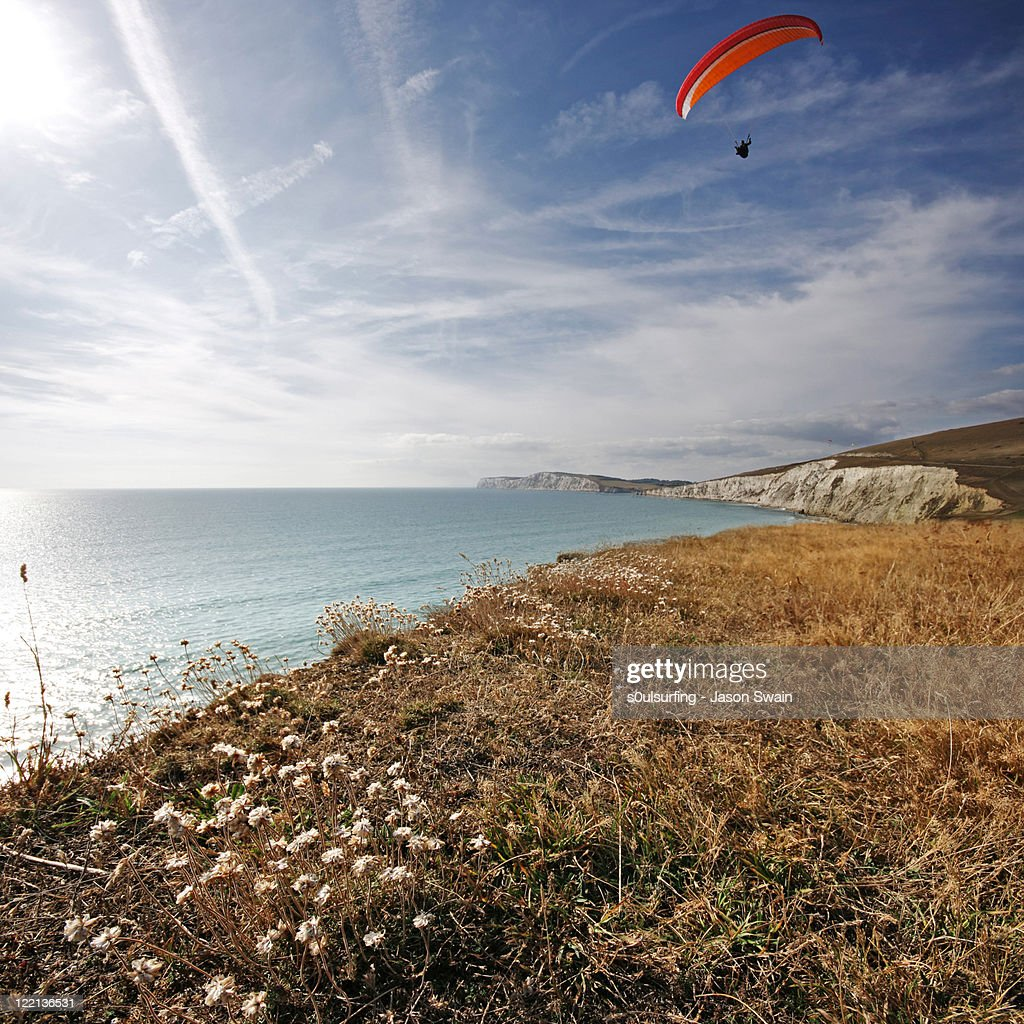 Paragliding over Compton Bay : Stock Photo