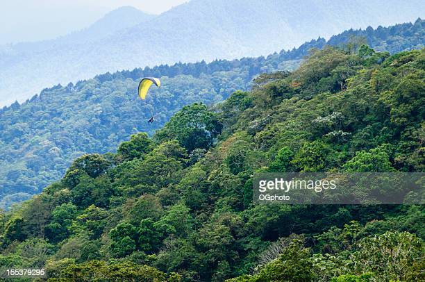 Paragliding over tropical forest