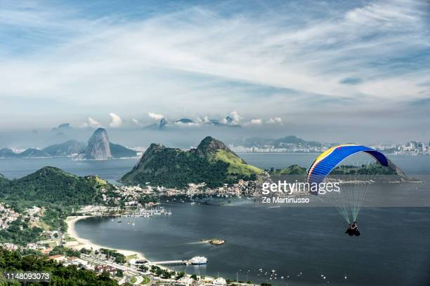 paragliding - niteroi stock pictures, royalty-free photos & images