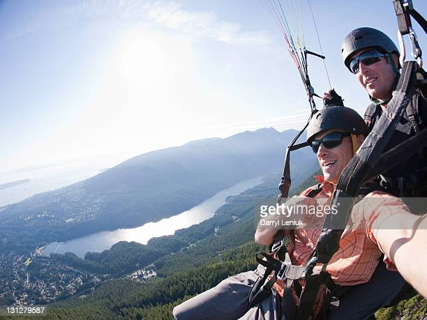 paragliding - grouse mountain stock photos and pictures
