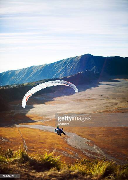 paragliding - mt bromo stock photos and pictures