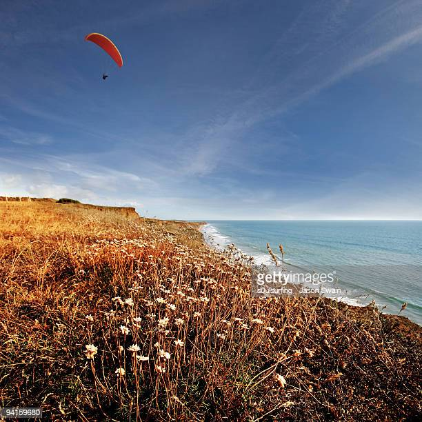paragliding - compton bay isle of wight stock pictures, royalty-free photos & images