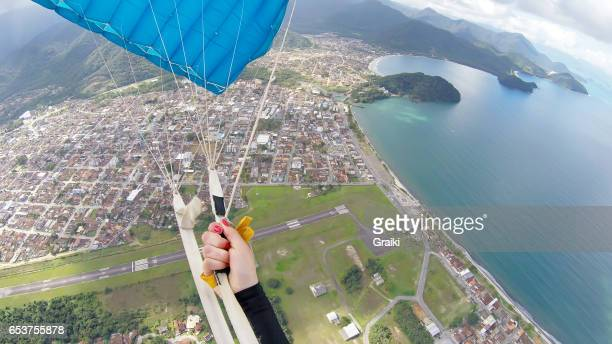 paragliding point of view - gliding stock photos and pictures