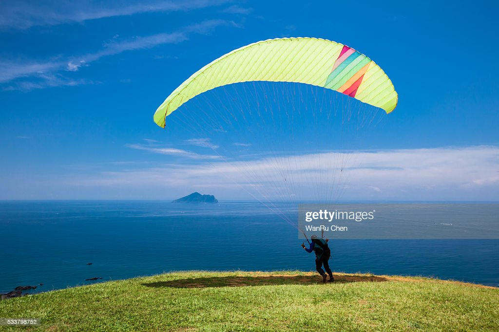 Paragliding with beautiful cloudscape background : Foto stock