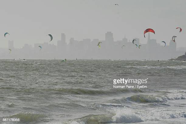 Paraglidings Over Sea In City