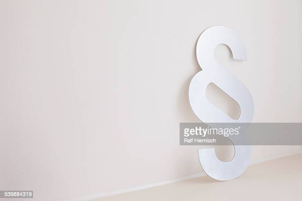 Paragraph sign against wall