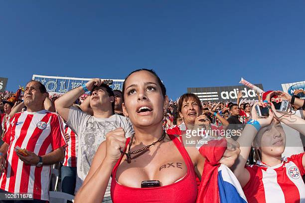 Paraguay fan and model Larissa Riquelme reacts during quarterfinal match of the World Cup football match Between Spain and Paraguay on July 3 2010 in...