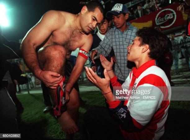 A Paraguay fan pleads for Paraguay captain Jose Luis Chilavert's shin pads