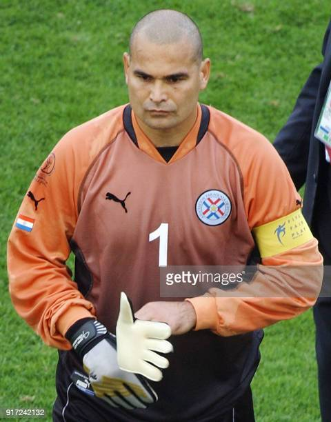Paraguay 'keeper Jose Luis Chilavert walks off the pitch 15 June 2002 at the Jeju World Cup Stadium in Jeju following second round playoff action...