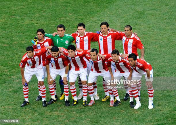 Paraguay line up for a group photo before the FIFA World Cup Round of 16 match between Paraguay and Japan at the Loftus Versfeld Stadium on June 29...
