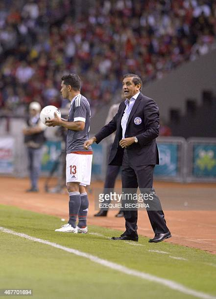 Paraguay national selection manager Ramon Diaz shouts as Paraguay's Miguel Samudio prepares to throw the ball during a friendly match at national...