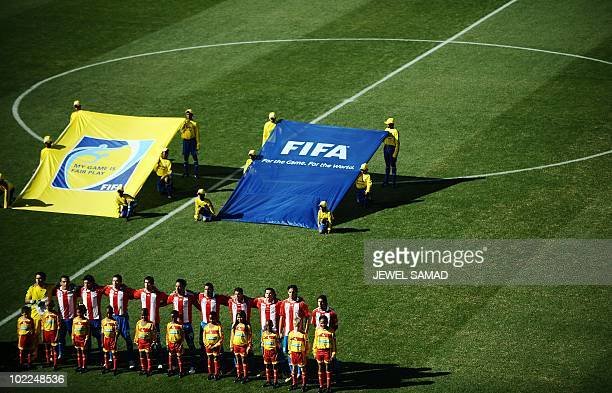 Paraguay players react to their national anthem before the start of the Group F first round 2010 World Cup football match between Slovakia and...