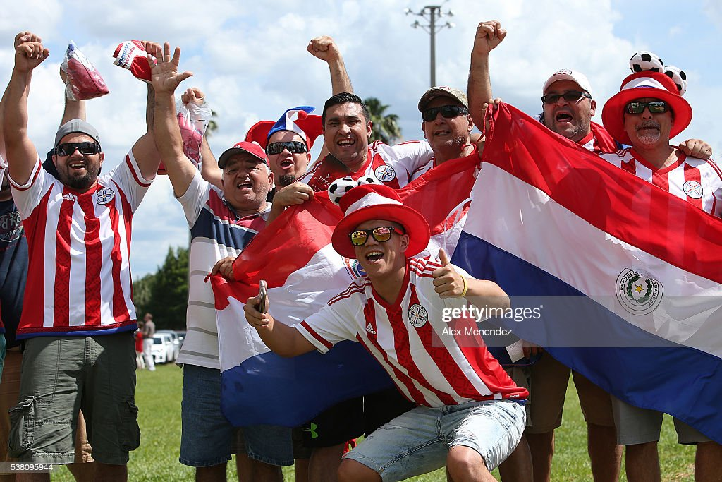 Paraguay soccer fans cheer in the parking lot prior to the 2016 Copa America Centenario Group A match between Costa Rica and Paraguay at Camping World Stadium on June 4, 2016 in Orlando, Florida.