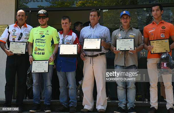 Paraguayan 2017 Dakar Rally competitors are honoured by Paraguay's government in Asuncion on January 25 2017 / AFP / NORBERTO DUARTE