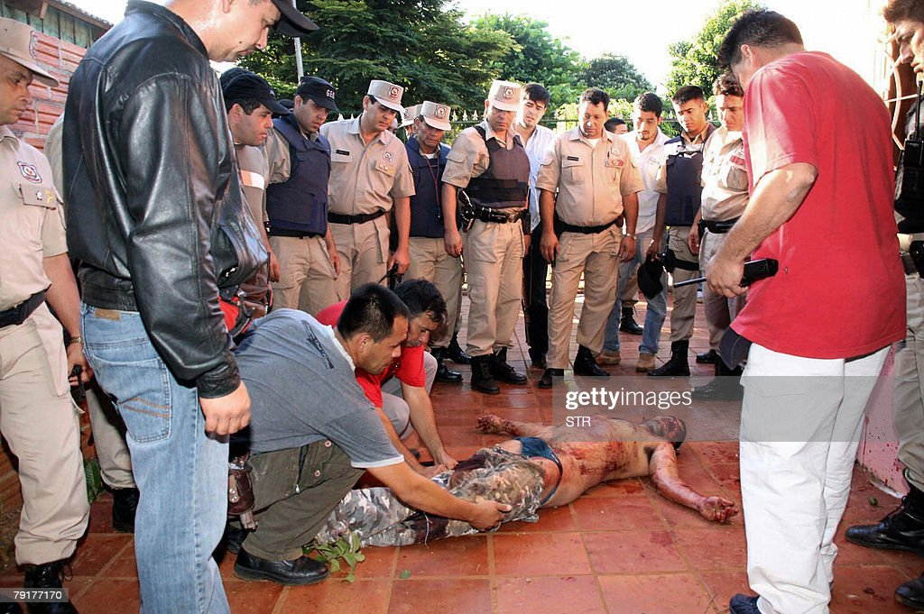 Paraguayan anti-kidnapping squad policemen identify 23 January, 2008 in Ciudad del Este, Paraguay, the corpse of Brazilian national Valdecir Pinheiro, leader of the gang that abducted Japanese Moon Sect representative Hirosaku Ota and his secretary on April 2007. Pinheiro, three accomplices and a policeman died in the shoot-out, police said.