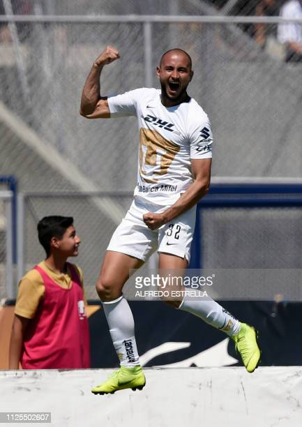 Paraguayan Carlos Gonzalez of Pumas celebrates after scoring against America during the Mexican Clausura football tournament match at the Olimpico...