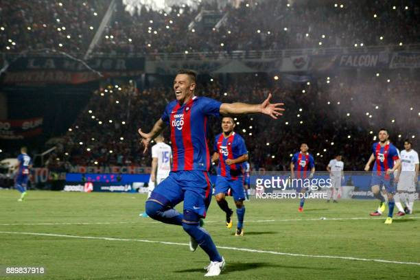 Paraguayan Cerro Porteno's Diego Churin celebrates with teammates after winning their 2017 Paraguayan Clausura Championship final match against Sol...
