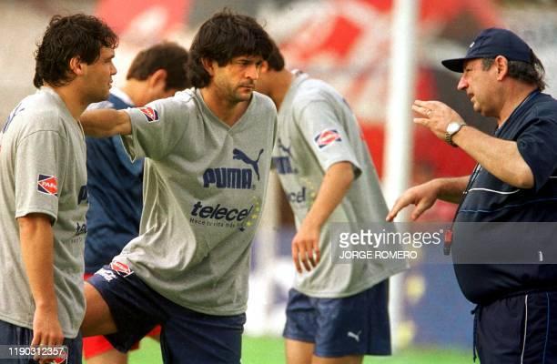 Paraguayan coach Sergio Markarian instructs his players Jose Cordoza Celso Ayala during practice in Asuncion 01 September 2001 Sergio Markarian...