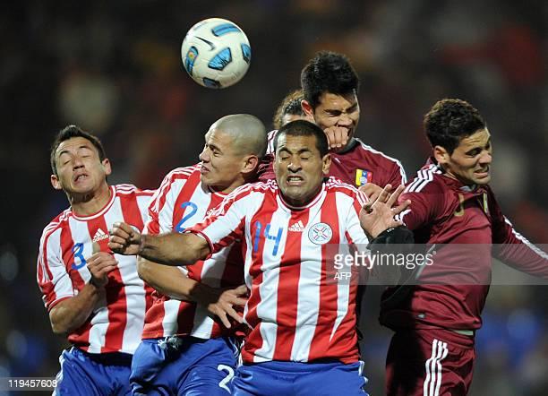 Paraguayan defenders Ivan Piris Dario Veron and Paulo da Silva vie for the ball with Venezuelan forward Nicolas Fedor and defender Gabriel Cichero...