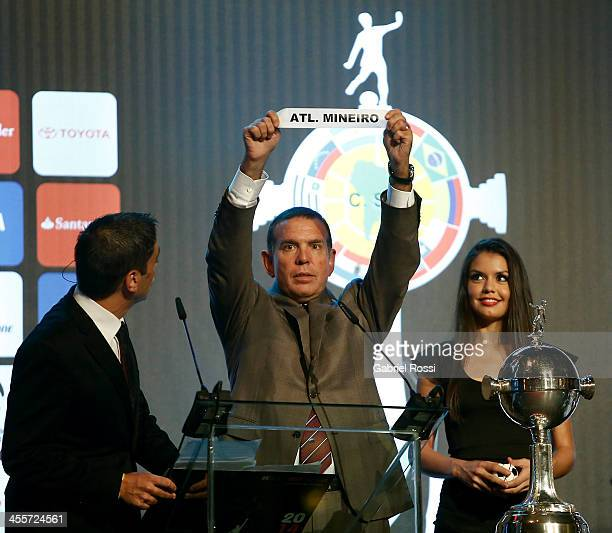 Paraguayan Football Association President Jose Angel Napout holds up the name of Atletico Mineiro of Brazil during the Official Draw of Bridgestone...