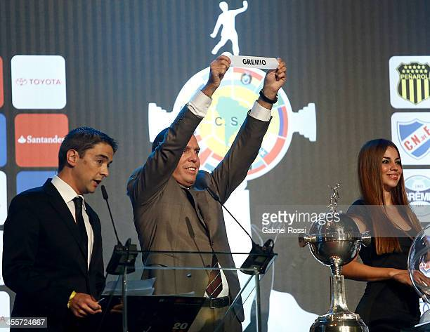 Paraguayan Football Association President Jose Angel Napout holds up the name of Gremio of Brazil during the Official Draw of Bridgestone...