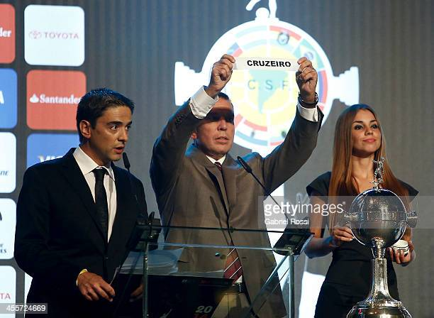 Paraguayan Football Association President Jose Angel Napout holds up the name of Cruzeiro of Brazil during the Official Draw of Bridgestone...