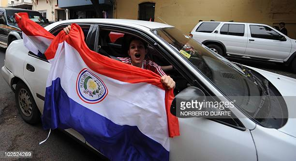 A Paraguayan football fan celebrates after Paraguay defeated Japan in the FIFA World Cup 2010 round of 16 match in downtown Asuncion on June 29 2010...
