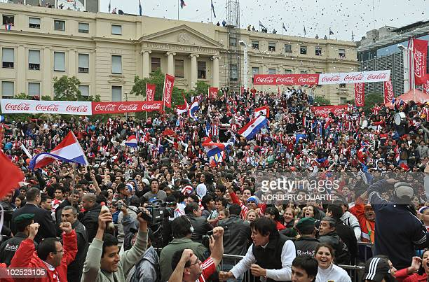 Paraguayan football fans celebrate after Paraguay defeated Japan in the FIFA World Cup 2010 round of 16 match in downtown Asuncion on June 29 2010...
