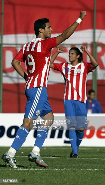Paraguayan football player Roque Santa Cruz celebrates his goal against Brazil during their FIFA World Cup South Africa 2010 qualifiers football...