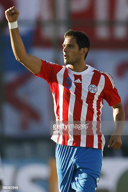 Paraguayan football player Roque Santa Cruz celebrates his goal against Brazil during their FIFA World Cup South Africa 2010 qualifier football match...