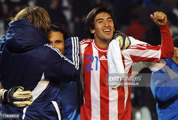 Paraguayan footballers Edgar Barreto goalie Justo Villar and Marcelo Estigarribia celebrate at the end of their 2011 Copa America semifinal match...