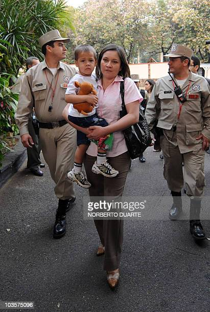 Paraguayan fortyyearold teacher Hortencia Moran arrives with her son Juan Pablo on August 24 2010 at the presidential residence in Asuncion where...