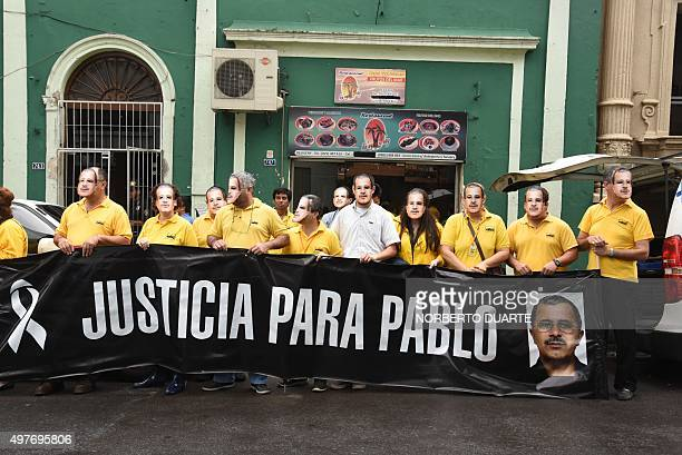 Paraguayan journalists protest against former Ypejhu mayor Vilmar Neneco Acosta in front of the prosecutor's office in Asuncion on November 18 2015...