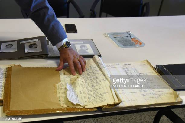 Paraguayan Judge Agustin Fernandez director of the Documentation and Archive Center for Human Rights Defense shows some of the documents that form...