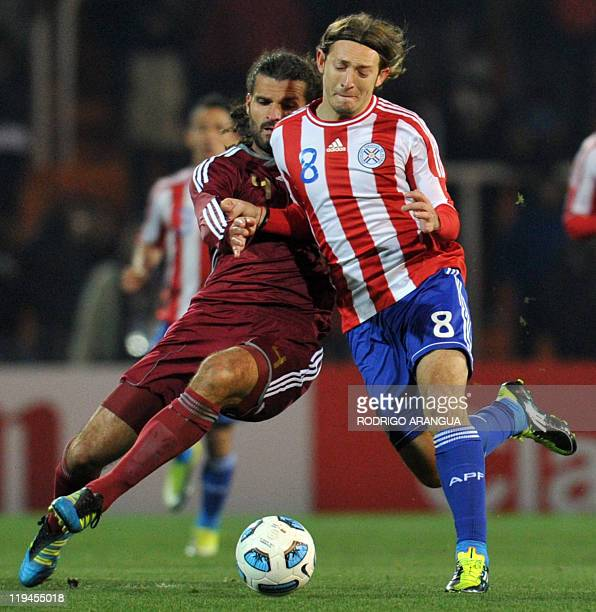 Paraguayan midfielder Edgar Barreto fights for the ball with Venezuelan defender Oswaldo Vizcarrondo during the 2011 Copa America semifinal football...
