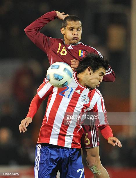 Paraguayan midfielder Marcelo Estigarribia jumps for the ball with Venezuelan defender Roberto Rosales during their 2011 Copa America semifinal...
