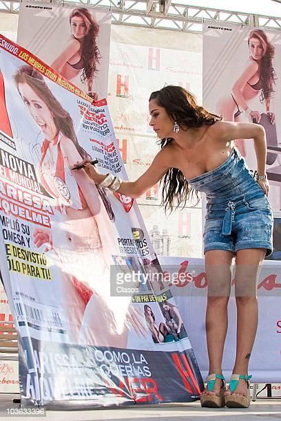 Paraguayan model Larissa Riquelme autographs a giant H magazine on Mexico City Mexico
